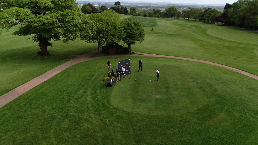 shot from top of golf players playing a match